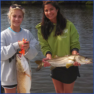 Nikki Miller and her daughter, Taylor, with nice redfish and snook.