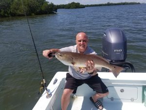Barry with an over slot Red Fish caught with Capt. Wes Wildman out of Island Discount Tackle